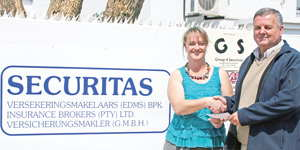 In the picture, Bertus Walters from Securitas (main sponsor) hands over a cheque to Heletjé Grobbelaar from the Bible Society of Namibia.