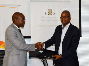 Mutual benefits: From left to right The Development Bank of Namibia CEO Martin Inkumbi and Tiroyamodimo Kayawe of Botswana development finance institution the Citizen Entrepreneurial Development Agency (CEDA) finalise an agreement to solidify similar interests of their institutions.