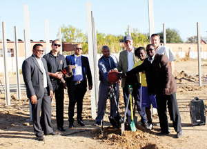 Left Bernard Kaanjuka, Acting Director of Sport in the Ministry of Youth, National Service, Sport and Culture, Frank Albin, Founder and Head Coach at BAS, H.E. Onno Hückmann, German Ambassador, Andrew Masongo (right), President of the Namibia Basketball Federation, together with other representatives from the ministry and  the contractor.
