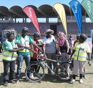 Katutura Central Councillor Ambrosius Kandjii (centre), joined by the Counsellor for Development Cooperation in the German Embassy, Annegret Al-Janabi (centre right) and enthusiasts supporting the pedal power initiative on the morning of the Windhoek on Bike day together with participants of the bike training