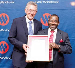 Lukas Nanyemba, Regional Executive: Corporate Banking, received the MD's Leadership award for management staff. He is pictured receiving the award from Christo de Vries, Managing Director of Bank Windhoek.