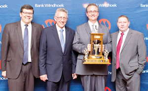 Bank Windhoek Mariental Branch scooped two awards for Best Overall Branch and Best Medium Branch at the Bank Windhoek Annual Executive Awards held recently in Windhoek. Pictured are Johann Schroer (second from right), Branch Manager of Mariental Branch with the floating trophy for Best Overall Branch, with Christo de Vries (second from right), Managing Director of Bank Windhoek, Chris Matthee (left), Executive Officer: Retail Banking Services at Bank Windhoek and Danie Louw, Regional Manager: South at Bank Windhoek.