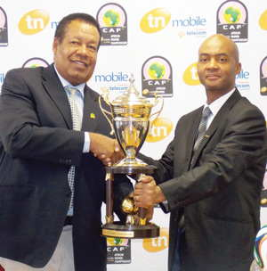 The silverware has arrived: Namibia Football Association (NFA) president, John Muinjo handing over the trophy to Amarndo Perny, Chief Mobile Officer of TN Mobile Namibia (Photograph by Comfort Ajibola)
