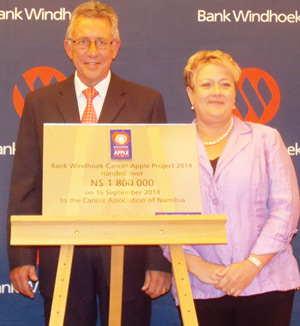 Managing Director of Bank Windhoek, Christo de Vries handing over to Reinette Koegelenberg, CEO of Cancer Association of Namibia