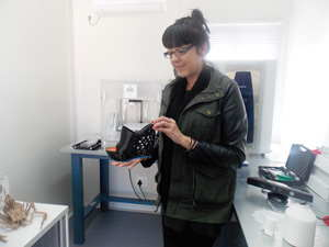 Kirstin Wiedow, Director and Co-founder of FABLab Namibia, with a shoe product printed out of the 3D-printer in their offices. (Photograhy by Comfort Ajibola)
