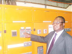 Tapping into renewable energy: Managing Director of NamPower, Paulinus Shilamba symbolically switching on the system in NamPower's bid to utilise energy from mother nature. (Photograph by Musa Carter)