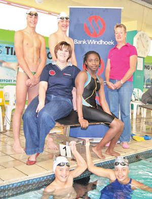 Put on your swimming caps: Pictured with some of the swimmers at the handover of the sponsorship are, Sanet de Waal, Communication Practitioner: Stakeholder Engagement at Bank Windhoek, (seated on left) and Bettina Steffen, President of NASU (standing on right).