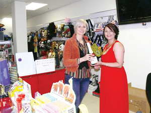 Esmeralda Ukena (left) from Agra hands over a gift to Marlene van Graan of Geek (right) Boutique to congratulate her on opening a business in the Auas Valley Shopping Mall