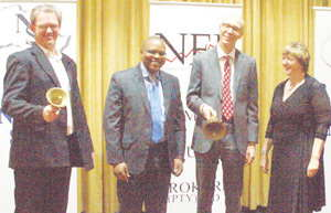 General Manager of the Namibian Stock Exchange, Tiaan Bazuin (left) leads the bell with Michael Ngwaba and Vladimir Nedeljkovic, respectively vice president and head of Exchange Traded Products at ABSA Capital, in the glowing company of the MD of Namibia Equity Brokers, Madelein Smith. The ETF were listed as a local asset class last week Friday.