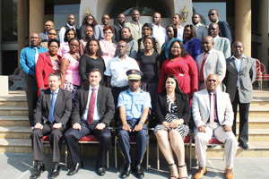 Major General Desiderius Shilunga, Namibian Police Regional Commander for the Khomas Region [in uniform] and sitting on his right, Director of the Financial Intelligence Centre of Namibia, Leonie Dunn and the other participants that attended a money laundering, financing of terrorism and proliferation financing workshop held in Swakopmund.