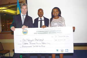 Rod Braby, (left) with Mr Ignatius Kauvee (Technical Advisor: NACOMA Project) and Ms Nangula Amutenya at the Nacoma gala dinner she received a grant to complete her Master's degree in Environmental Management.