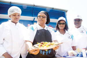 The Mayor of Otjiwarongo, Cllr Hilda Jesaja (second from left) appreciating the talented work of the Fish Consumption Trust's in-house chef, Beauty Shanjengange (left). Equally appreciative of the delicious piscean platter are the Minister of Fisheries and Marine Resources, Hon Bernard Esau, and the Governor of Otjozondjupa Region, Hon Samuel Nuujoma.