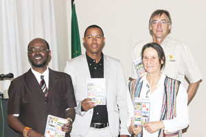 Sam Shilongo Director of Ministry of Environment and Tourism, Kenneth Uiseb, Deputy Director of Scientific Services at the Ministry of Environment and Tourism, Holger Kolberg, Senior Conservation Scientist and MET Ornithologist and Elizabeth Komen, Director of NARREC and Member of Veterinary Council of Namibia holding up their copies of the Booklet.