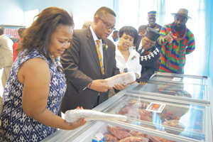A long way from the sea, Minister of Fisheries and Marine Resources, Hon Bernhard Esau appreciates the different types of fish available in the Mariental Fish Shop. His eager co-shopper is the Governor of Hardap Region, Katrina Hanse-Himarwa. (Photograph by Hilmah Hashange)