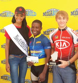 From left to right:.The beautiful, Brumilda Ochs (Miss Namibia 2014) poses with Johannes Shikwena (3rd), and winner Michael Pretorius.