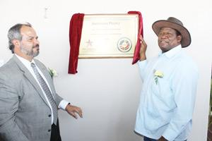 Minister of Agriculture, Hon John Mutorwa (right) unveiling the plaque with U.S. Embassy official Ivan Rios to inaugurate the Outapi State Veterinary Office.