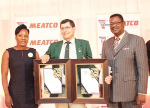 From left, Meatco Board Chairperson, Martha Namundjebo-Tilahun, Meatco's 2014 Producer of the Year, Benjamin van Wyk, and Meatco Chief Executive Officer (CEO), Adv. Vekuii Rukoro.