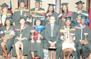 Some of the business graduates who received their degrees at last week's ceremony with SBS Namibia Director Albin Jacobs.