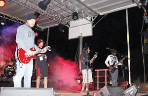 Safe 19, an alternative rock band, rocking it hard at one of their shows.
