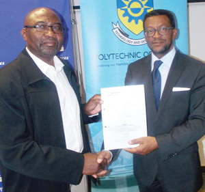 (L-R) Mr Niilo Taapopi, Chief Executive Officer, City of Windhoek and Prof. Tjama Tjivikua, Rector, Polytechnic of Namibia, holding the Memorandum of Understanding (MOU), on the development of promotional and sustainable tourism destination strategy yesterday at the Polytechnic Hotel School. (Photograph by Mandisa Rasmeni)