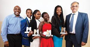 The Model UN Namibia team, Eerike Kahamundu, Martha Frans, Rachel Nghimulitete and Bianca Mungunda, with the South African Deputy Minister of Basic Education, Mr Enver Surty (right), and the Education Africa's deputy president, Mr Russell Zama (left). The Namibian team presented Canada in the two Model General Assembly debates on the Economic Benefits vs the Environmental Impact of Fracking; and on State-sanctioned homophobiai.e. universal human rights vs state sovereignty.
