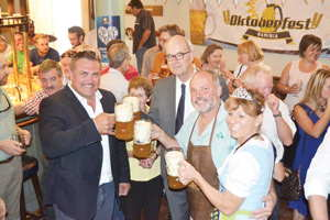 German Ambassador, His Excellence Onno Hückmann (standing in the centre) with dignitaries and members of the Oktoberfest organising committee, celebrating the announcement of this year's Oktoberfest later this month.