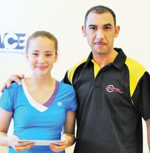 Girl's winner Kaitlyn Beukes with NTTA chairman Reinhardt Stanley.