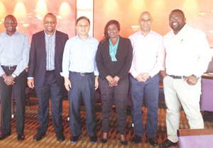 From the left are Victor Ashikoto (Namport ICT Executive), Bisey Uirab (Namport CEO), Dr. Henry Chan (Namibian Honorary  Consul to Hong Kong), Charity Mwiya (NCCI Member Services Manager), Johny Smith (CEO of the Walvis Bay Corridor Group), Elias Mwenyo (Namport Sales & Services Manager) during business meetings in Hong Kong.