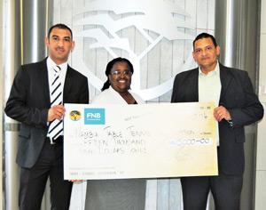 FNB Namibia's PR & Sponsorship Manager Ingrid Goeieman (middle) hands over a N$15,000 sponsorship to NTTA members Fabian Tait (left) and Reinhardt Stanley (right).