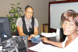 Good client services are the lifeblood of any business: Client service consultant' Erica Hengari assists a client with a payment as Sanlam Namibia Holdings officially began using a Point of Sales (POS) system at its branches.