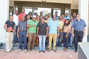 Participants that took part in the training workshop at the Rundu Fresh Produce Business Hub stand with Daan Strauss, Workshop facilitator.