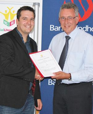 Bank Windhoek and the Financial Literacy Initiative (FLI) signed a Memorandum of Understanding (MoU) on Wedneday. The MoU will govern the terms of cooperation between and among the platform partners of FLI. Pictured at the signing of the MoU are Francois Brand (left), Manager of FLI and Christo de Vries (right), Managing Director of Bank Windhoek.