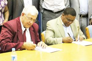 Pen to paper: Namibian Institute of Mining and Technology (NIMT) and TransNamib Holding Ltd acting CEO Hippy Tjivikua cement the institutions skills development by signing an MoU this week at TransNamib headquarters in Windhoek.