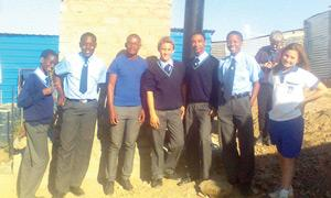 The Environmental Club members of Erwen and St Paul's College pictured at the new Otji toilet they have donated.