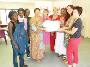 When two charities meet: Beate Shaanika, Foibe Kashikola and Ester Ndemuweda (students at Women at Work), Sustjie Mbumba, (Director of Women at Work), Pat Sivertsen (Training Manager: Women at Work), Leonie Lubbe (General Manager: Women at Work), Sara Shikongo (Director: Women at Work), Jennieke Kafuta (Project Manager: Beautiful Kidz Anusa) and Riana Brandt (Director: Women at Work).