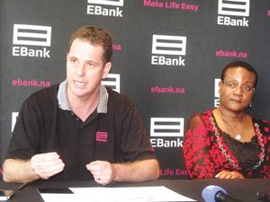 Chief Operating Officer of EBank Gerald Riedel and Engen Namibia Managing Director Nangula Hamunyela, sealing the agreement that will see Ebank services rolled out at Engen service stations. (Photograph by Melba Chipepo).
