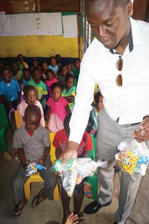 MTC Chief Human Capital and Corporate Affairs officer, Tim Ekandjo enjoying himself bringing joy to vulnerable children.