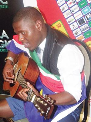 An emotional Permithias singing one of his song to his mother at a press conference held for him on 12 November by MulitiChoice Namibia. (Photograph by Mandisa Rasmeni)