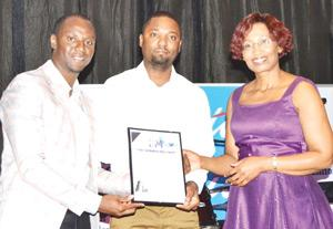 From left to right: Tim Ekandjo, President of the Institute of People Management, Khumalo Kapelwa, Industry Liaison Officer of the Cooperative Education Unit at the Polytechnic, and Dr. Mpuang, MD and guest speaker at the institute's recent awards dinner.