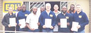 Nine newly qualified auditors have already assisted with the implementation of a quality management system (QMS) based on ISO 9001:2008 standards. L to R: Rodrieck Snyders, Moses Haimbodi, Benjamin Irua, Benster Ntesa, Gavin Brasler, Claus Zeilinger, Absolom Fillipus, Erwin Keiseb, Lukas Engelbrecht.