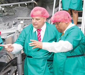 Volkers Paulsmeier, General Manager of Gendev Group Namibia explains some of the workings to the Hon. Minister Bernard Esau in the fish factory.