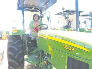 A John Deere loves the soil. Claudia Mukete from Okakwa in the Ohangwena region behind the wheel of her and husband Festus' brand-new tractor.