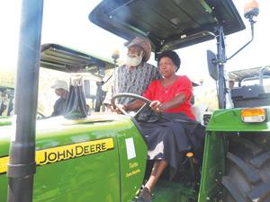 Is it mine, yours or ours? A proud Immanuel and Albertina Velikoshi from the Oshikoto region take their brand-new John Deere tractor and ripper for a test drive.