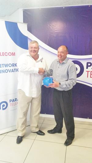 Paratus Telecom Group CEO, Barney Harmse (left) with Vox Telecom CEO: Jacques du Toit, safeguarding the proverbial piggy bank to settle the deal. Paratus announed this week it has acquired the full shareholding of Vox Telecom.