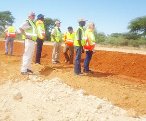 In front: Nick Putter – Project Director; Gerson Karaerua Roads Contractor Company GM Business Development and Corporate Services; Sonia Bergh Roads Contractor Company Board Chair person checking on the progress of the  Gobabis – Aminuis – Aranos project.