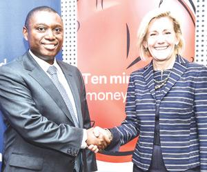 Sim Tshabalala (left) CEO of Standard Bank South Africa, with Pamela Patsley, CEO of MoneyGram, after renewing an extensive agreement for Standard Bank to use MoneyGram's trading platform for transferring funds where conventional banking channels are weak.