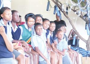 Choir members of the Shalom Primary School Choir assisted by distributing Christmas gifts to all the elders at this week's Otavi Elders Christmas party.