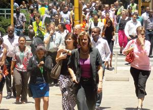 Tenants and workers from Old Mutual Towers during the evacuation drill assisted by fire marshals and first aid officers (Photograph by Mandisa Rasmeni).