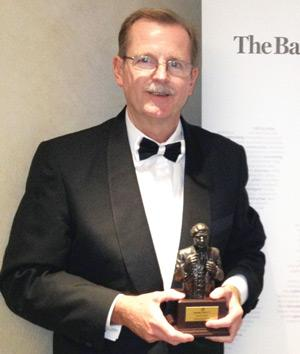 Ian Leyenaar, CEO of FNB Namibia, receiving the Banker Award for FNB Namibia at the gala awards evening in London.