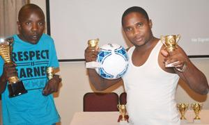 No these are not boxing trophies, but these came courtesy of the teambuilding exercise that was conducted by NAC during the months of October and November. Participants of the exercise show of some energy holding the silverware.